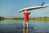 launching stand up paddleboard
