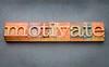 motivate word in letterpress wood type