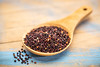 quinoa grain on wooden spoon