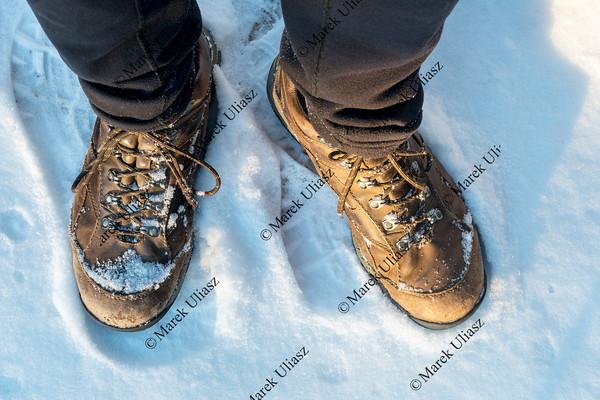 hiker feet on snowy trail