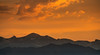 silhouette of mountains against sunset sky