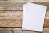 blank paper notebook on rustic wood