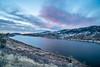 winter dawn over mountain lake