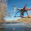 hexacopter drone flying over lake