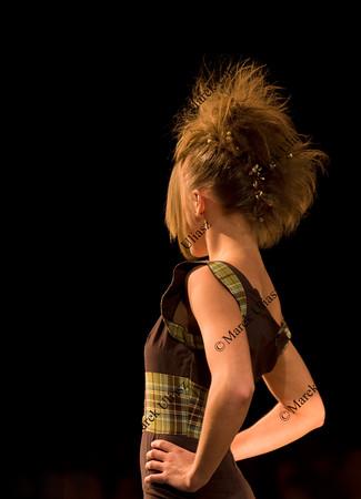 slim blond female model during fashion show