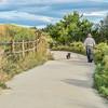 Morning walk with dog  on bike trail