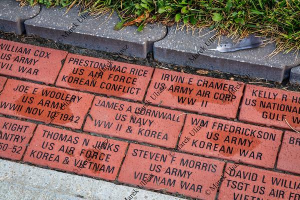 Engraved veteran memory bricks in Sedalia
