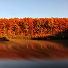 Swirling reflections with fall colors