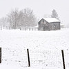 Old barn in a snow storm