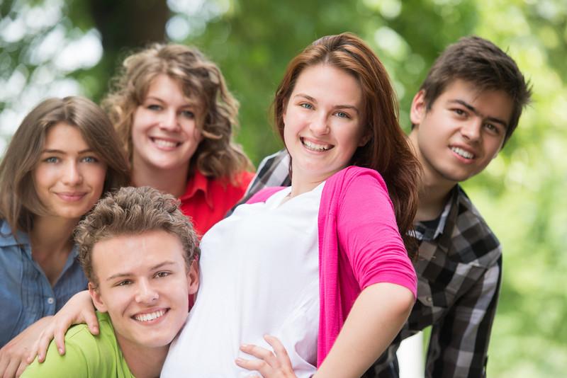 Five teenagers posing