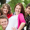 Five teenagers posing