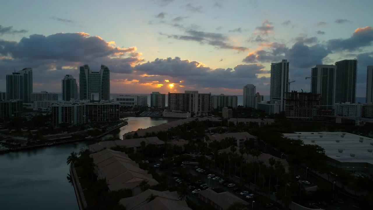 Aerial drone video footage beautiful sunrise over ocean condominiums beachfront