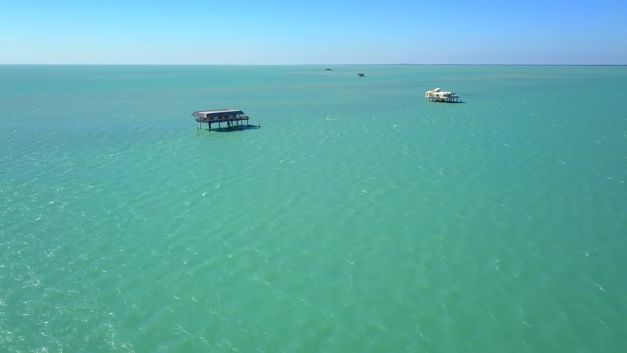 Drone video Stiltsville wood stilt houses Biscayne Bay Miami Florida 4k 24p