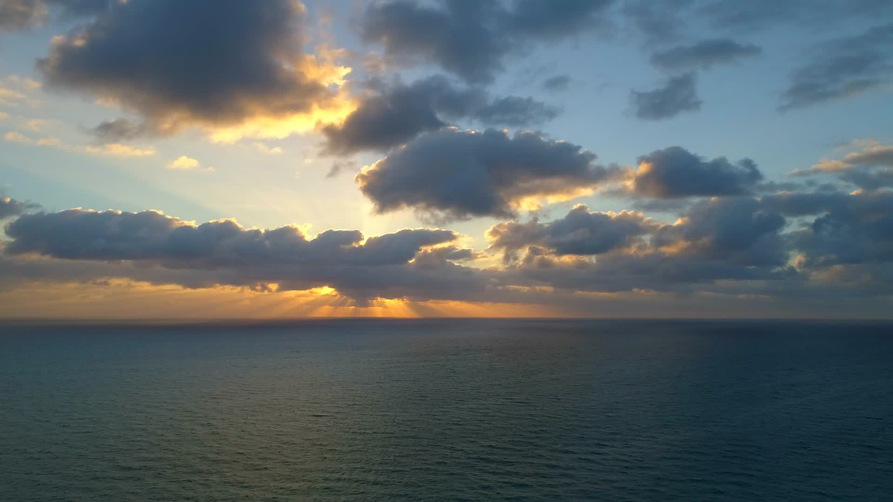 Pull out aerial drone hyperlapse sunrise beach condominiums