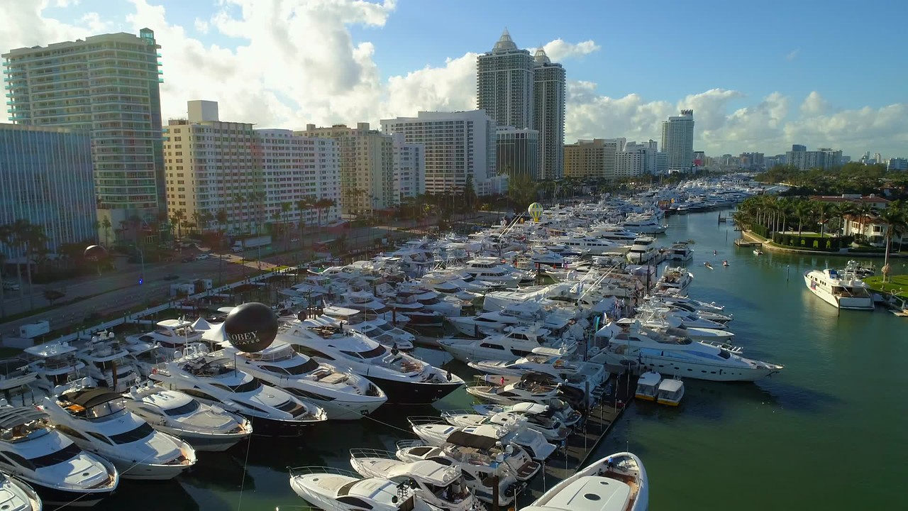 Aerial reveal rising above Miami boat show 2018 4k 60p