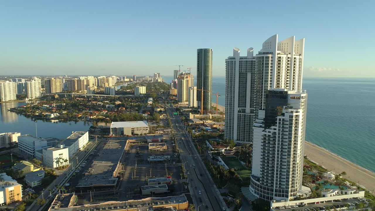 Aerial reveal condominium development Sunny Isles Beach Florida drone footage