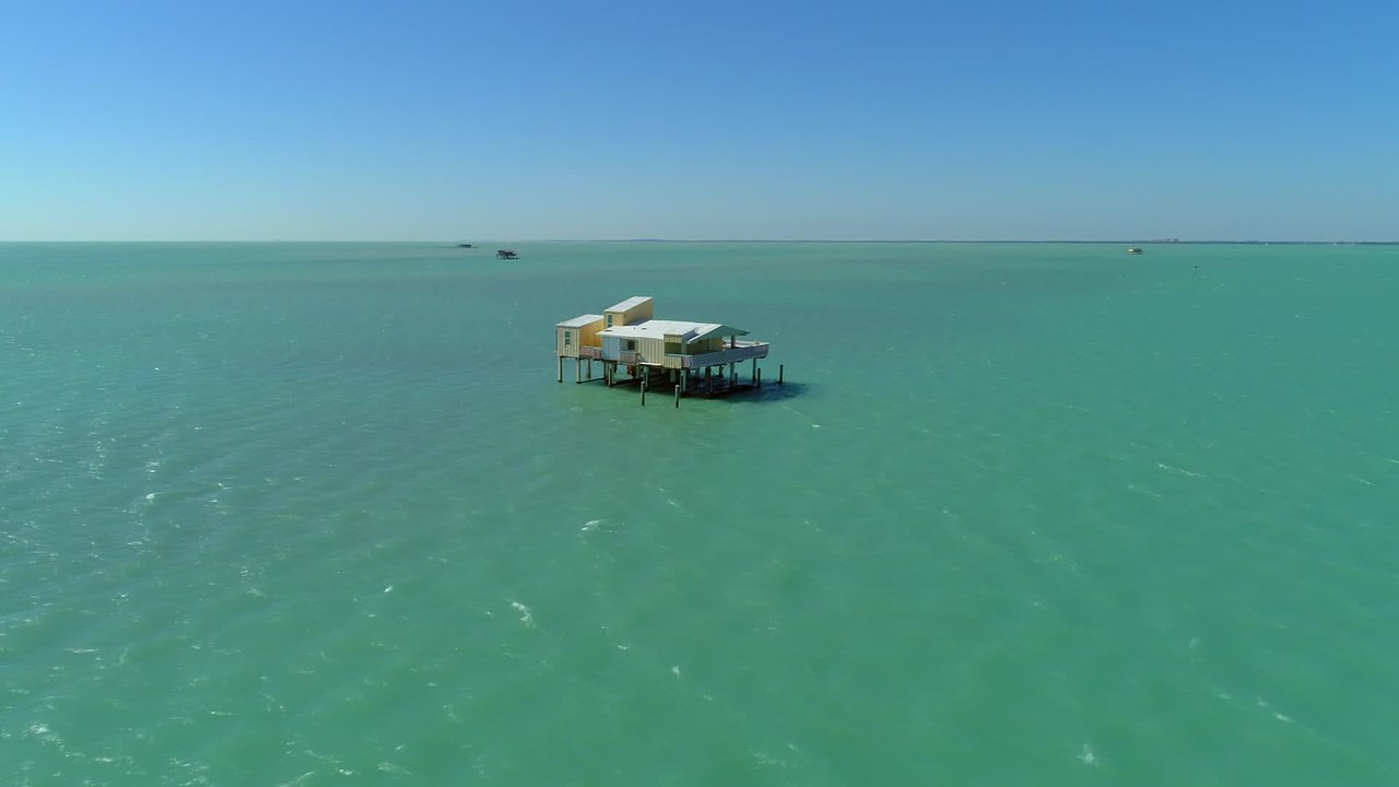 Aerial cinematic video house on stilts in the water Stiltsville Florida USA