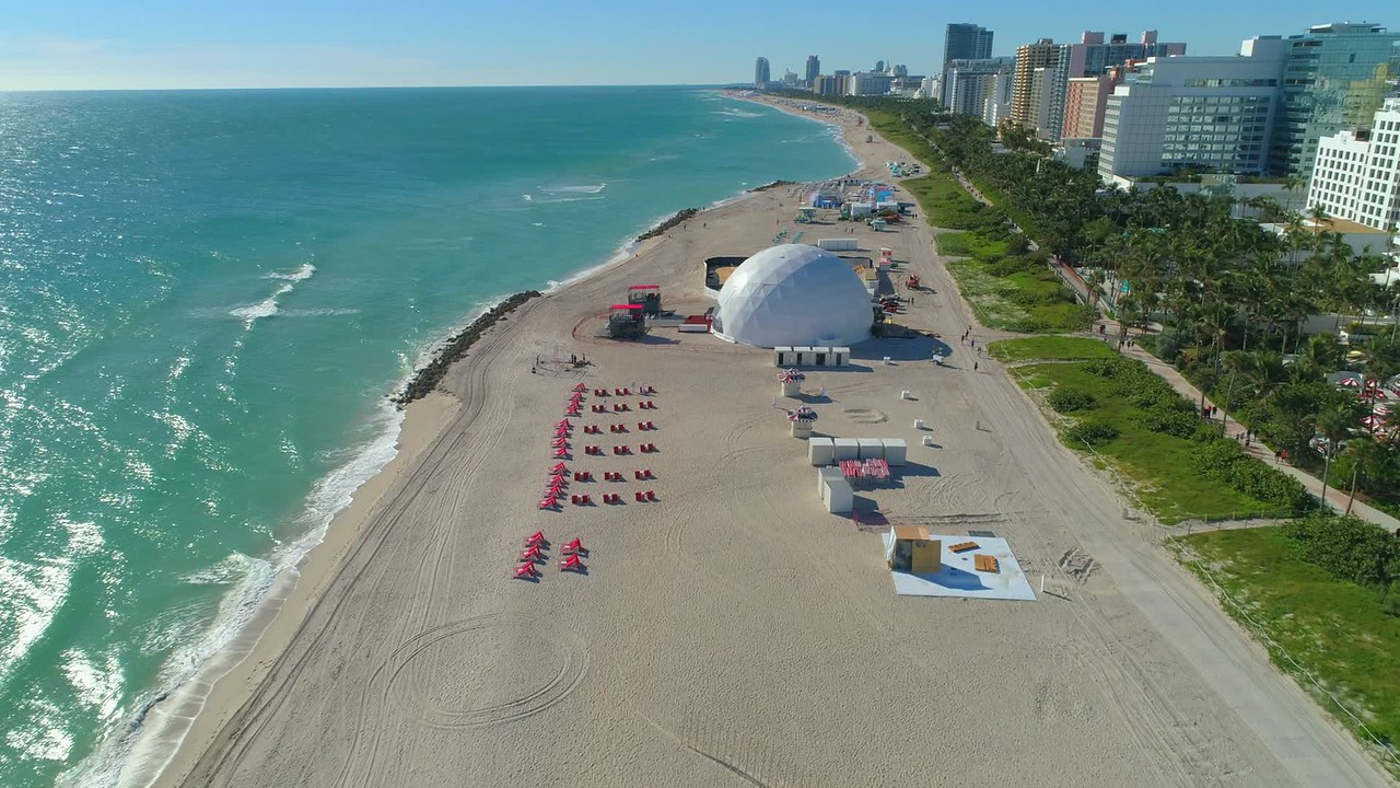 Aerial drone video Miami Beach 2017 Art Basel come tent on the sand