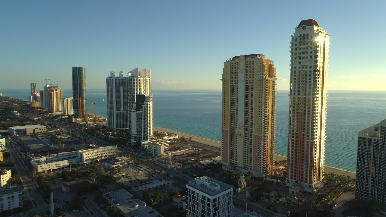 Drone approach highrise condominium apartment buildings Sunny Isles Beach FL USA