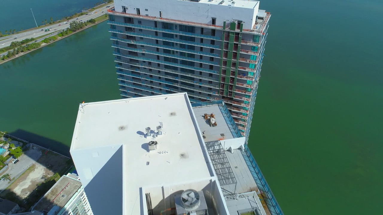 Aerial video Miami luxury highrise apartments on Biscayne Bay development 4k