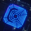 Aerial spin over a building with blue lights
