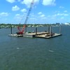 Construction crane on a barge in water 4k 60p