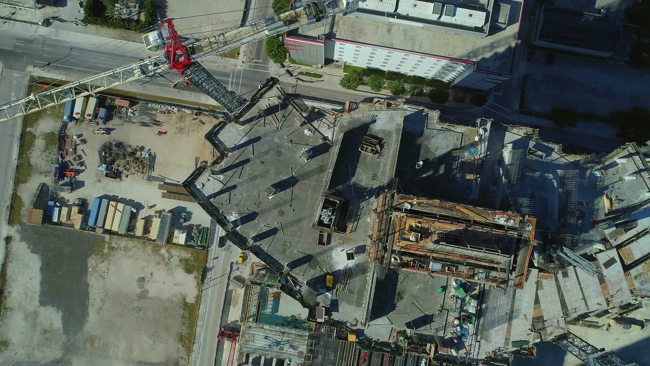 Industrial construction site rooftop flyover facing down drone 4k 24p