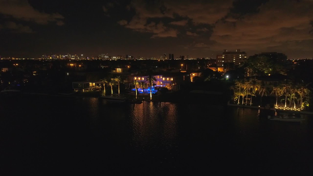 Aerial video of luxury Miami Beach mansions at night