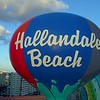 Aerial pull out footage Hallandale Beach water tower reveal 4k drone