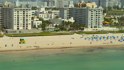 Umbrellas on the sand Miami Beach telephoto lens footage