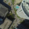 Aerial spin direct overhead shot architecture and road with cars