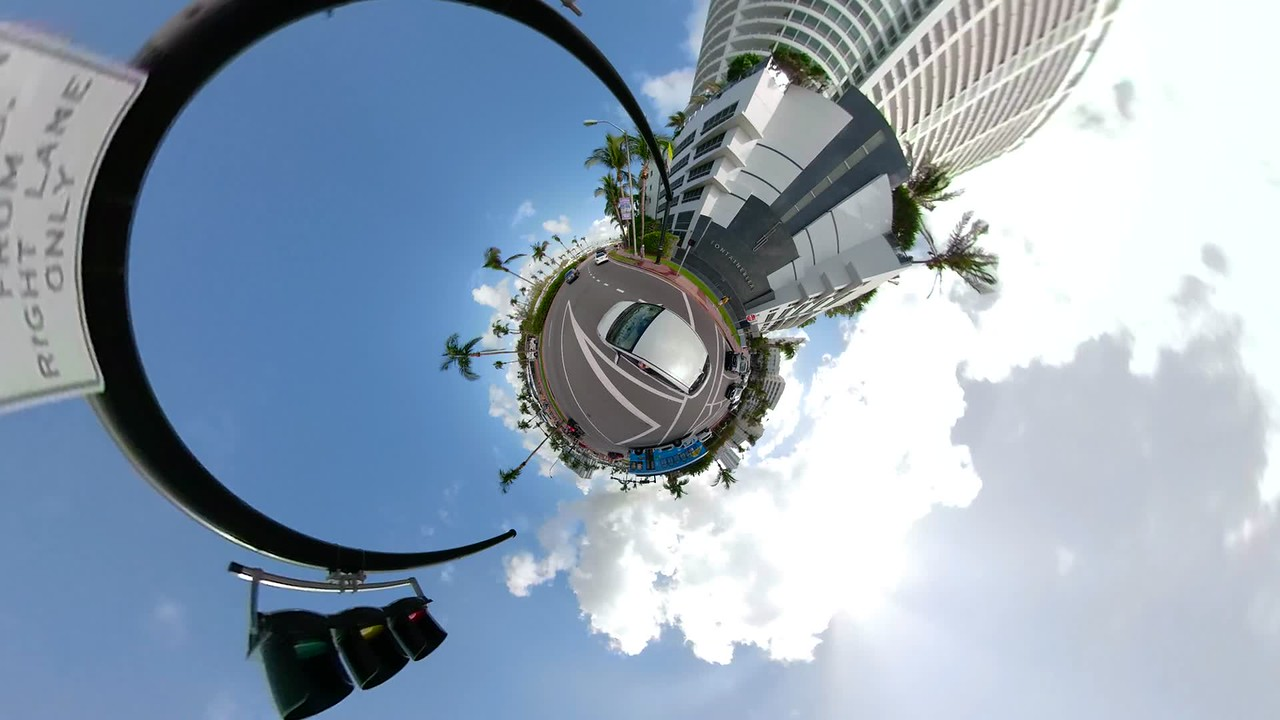 Car driving Miami Beach stop and go traffic tiny planet footage