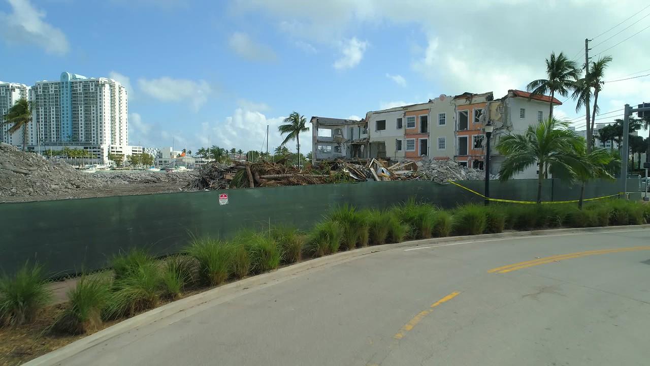 Construction fence flyover reveal destruction site