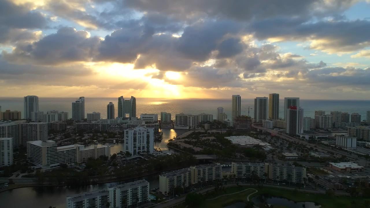 Aerial drone footage flying towards sunrise