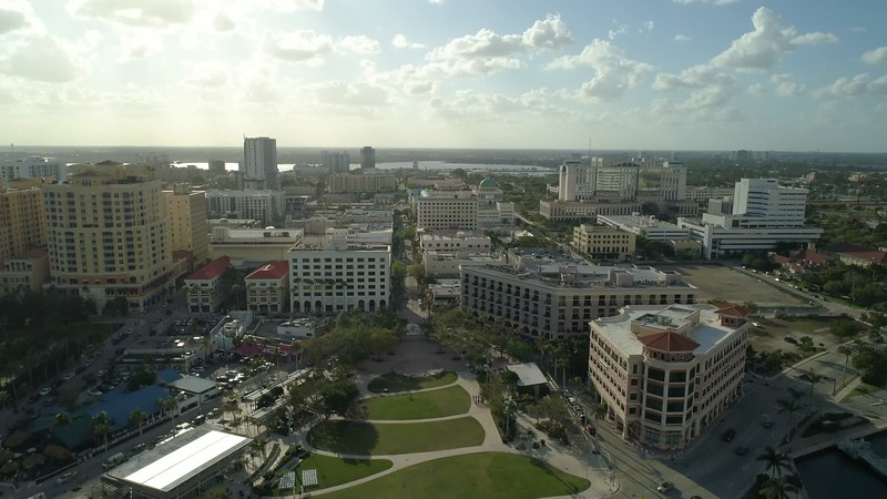 Aerial sped up flight over Clematis Street West Palm Beach FL