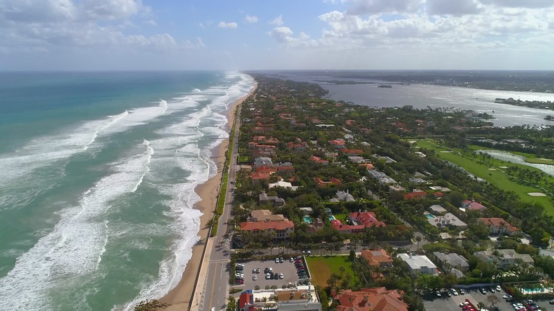 Homes close to the beach Florida coastline aerial drone video