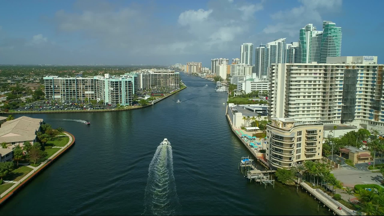 Aerial video waterfront condominiums Hallandale Hollywood Florida USA Intracoastal 4k 60p
