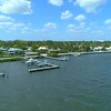 Aerial approach West Palm Beach Flagler Drive and marina with boats