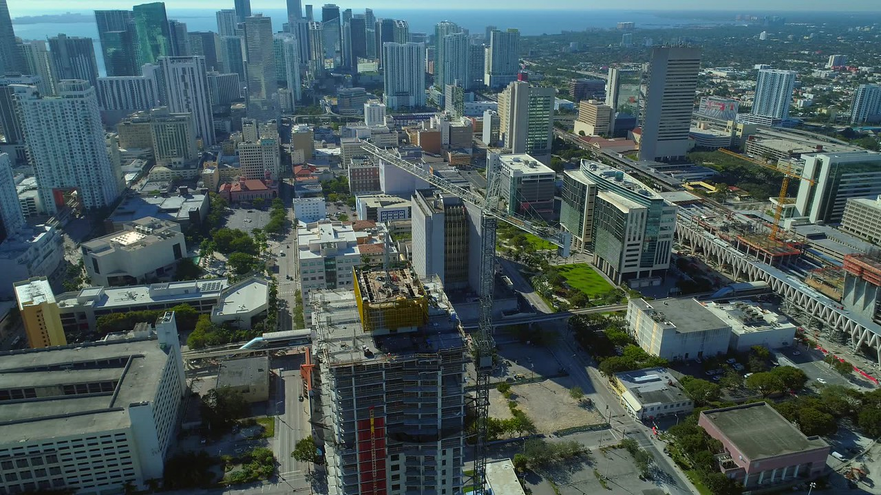 Drone shot of highrise skyscraper construction in a downtown district 4k 24p