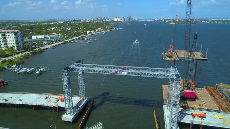 Drone footage bridge construction industrial inspection flyover