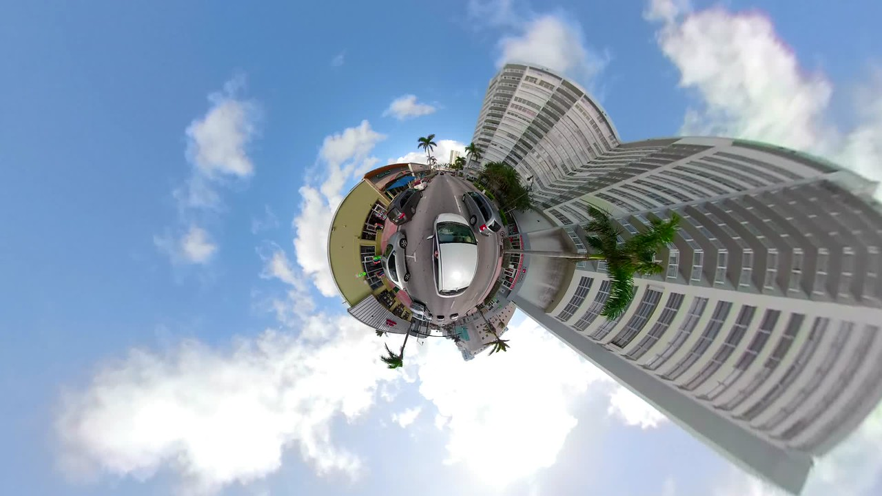 Stabilized motion footage driving on a miniature planet Miami Beach Collins Avenue