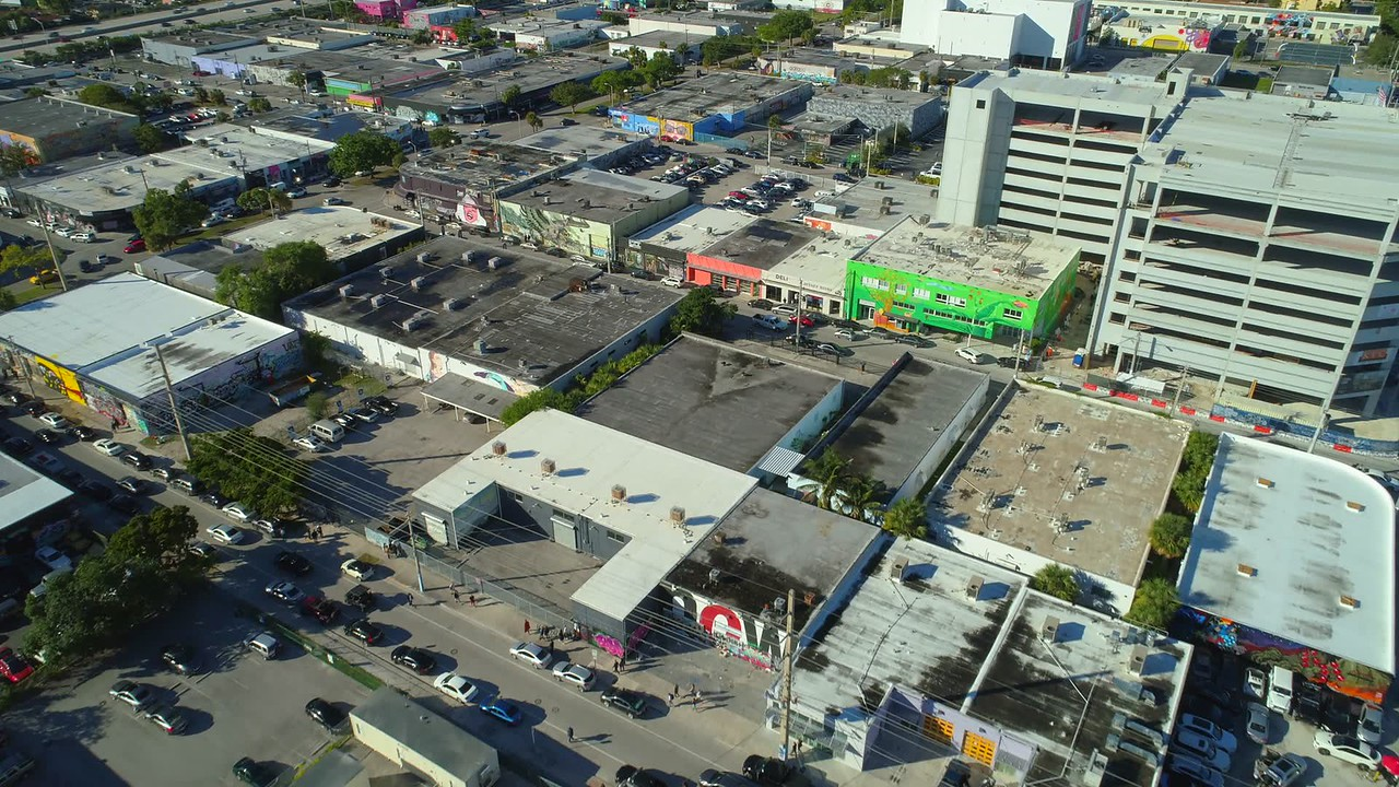 Aerial Miami drone shot of Wynwood urban city art walls