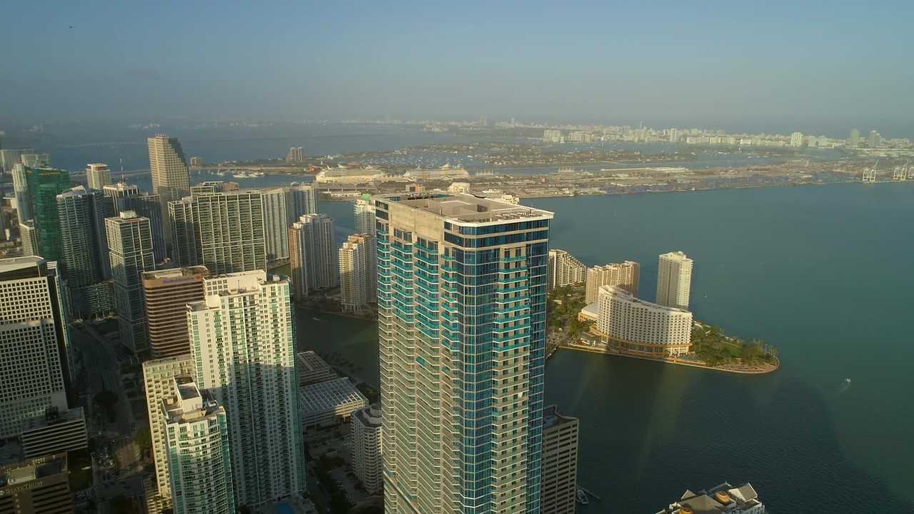 Aerial video Brickell Miami Panorama Tower overlooking biscayne bay 4k 60p