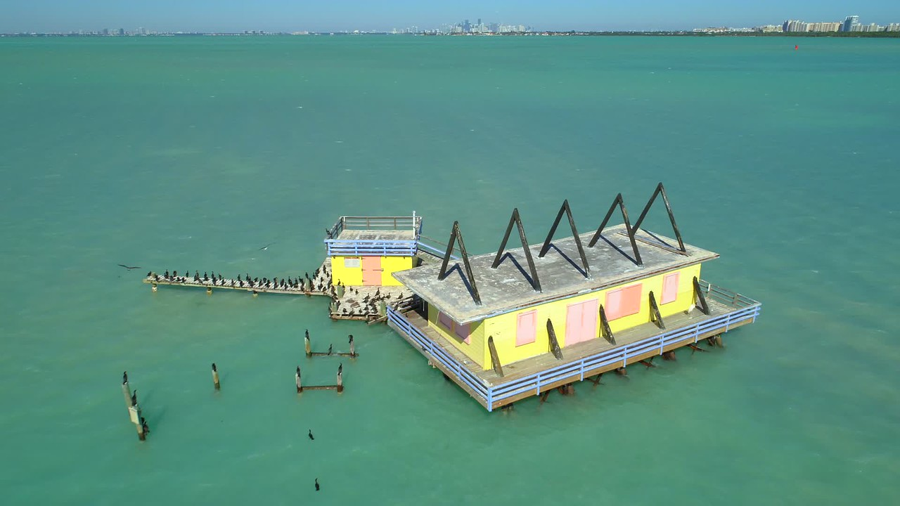 Aerial video ocean home in the middle of nowhere