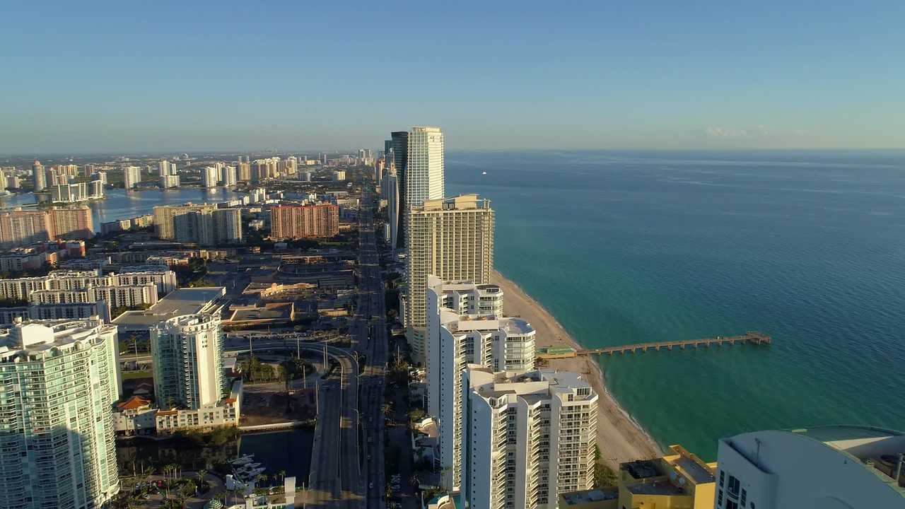 Aerial orbit Sunny Isles Beach fishing pier 4k