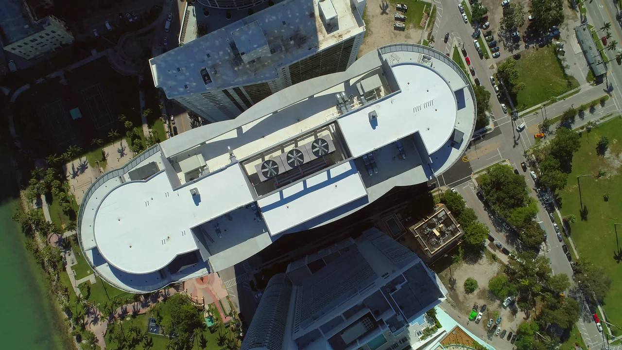 Aerial highrise building rooftop flyover inspection drone 4k