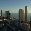 Aerial drone approach Sunny Isles Beach luxury condominiums 4k