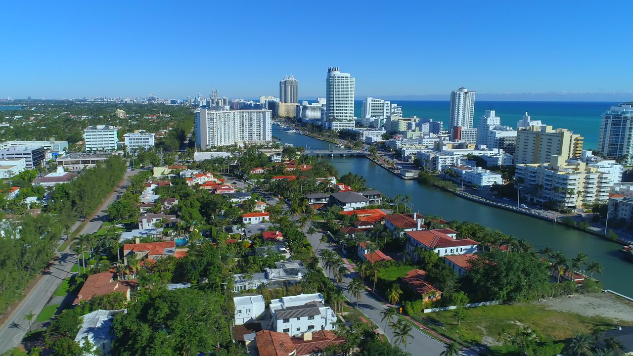 Aerial video Miami Beach condominiums on the water
