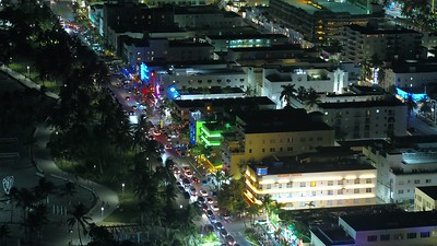 Narrow angle aerial drone footage Miami Beach Ocean Drive at night