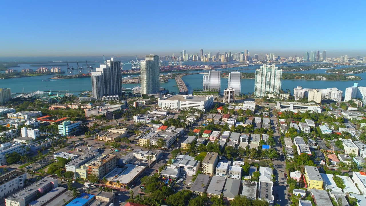 Beautiful aerial video Miami Beach FL view of Downtown over the bay